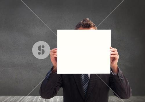 Businessman covering his face with placard