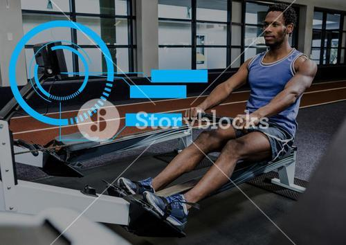 Fit man performing seated row exercise in gym with fitness interface