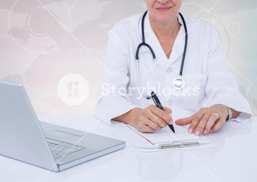 Doctor writing on clipboard on desk with digital world map in background