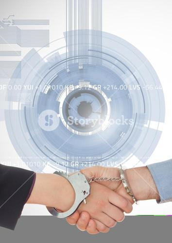 Business professionals shaking hands with handcuff against technology background