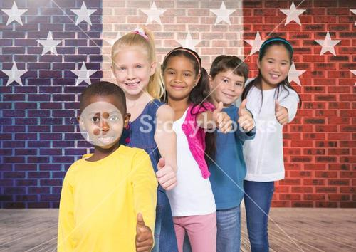 Children doing thumbs up gesture with France national flag in background