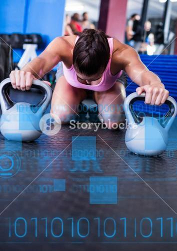 Fit woman performing fitness exercise using kettlebell in gym with fitness interface