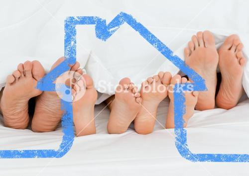Family sleeping together with house outline