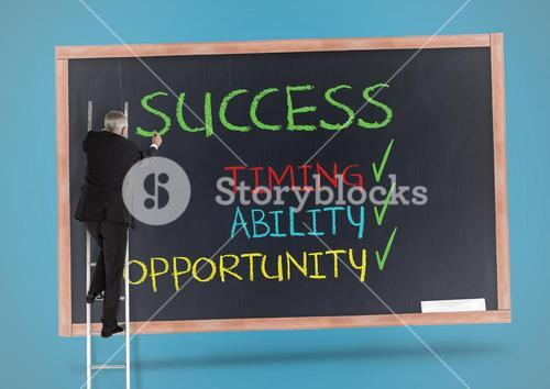 Businessman standing on the ladder and writing success concept on blackboard