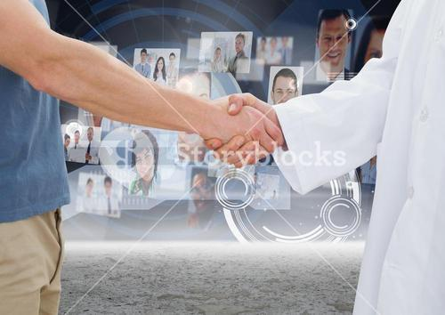 Business executives shaking hands against profile pictures in background