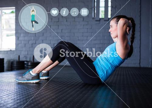 Woman performing abdominal exercise in fitness studio
