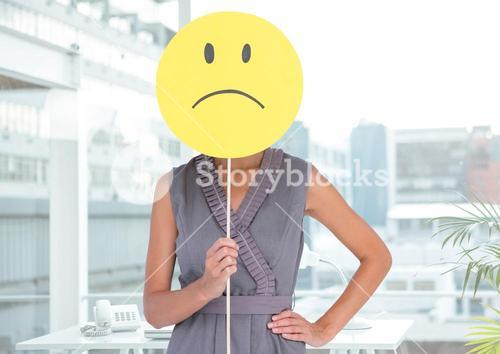 Woman covering her face with sad smiley