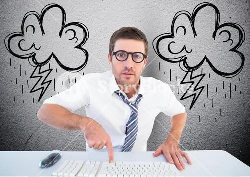 Businessman typing on desktop computer with lightning cloud in background