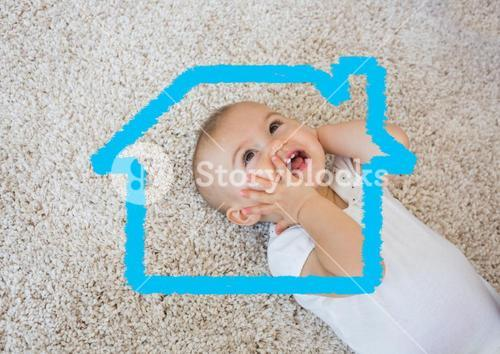 Home outline with smiling baby in background