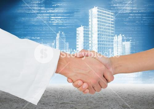 Doctor and patient shaking hands against cityscape in background