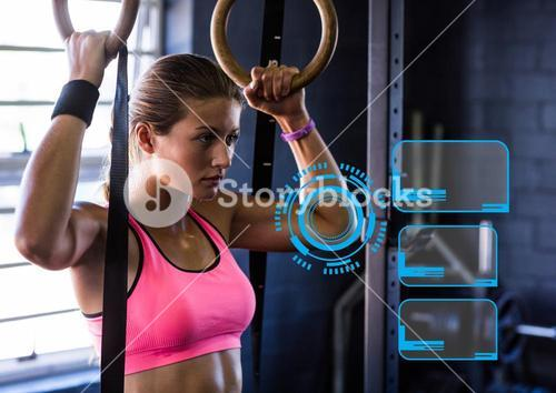 Woman practicing gymnastic exercise against digital interface in background