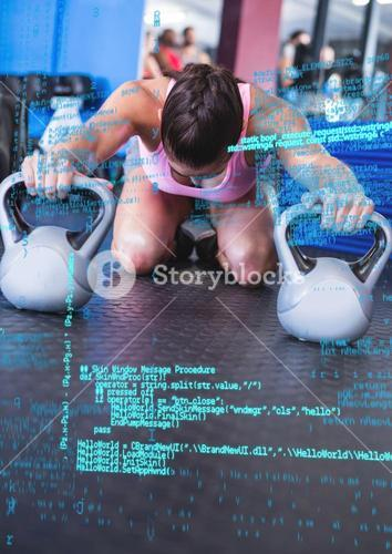 Digital coding screen against a woman working out with kettle bell
