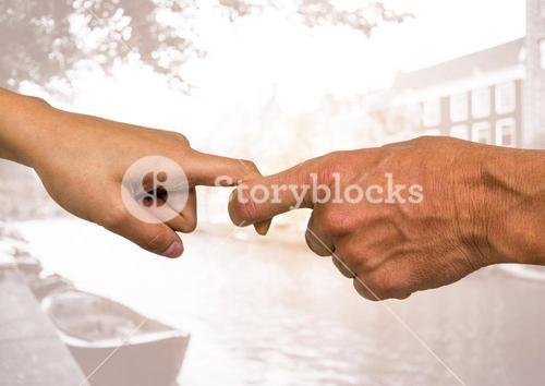 Hands of couple holding each others finger