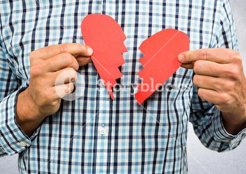 Man holding broken heart