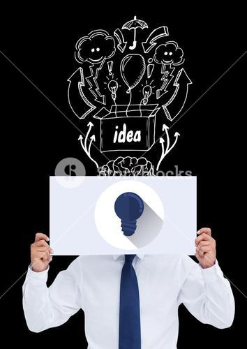 Conceptual image of businessman covering face with paper against black background