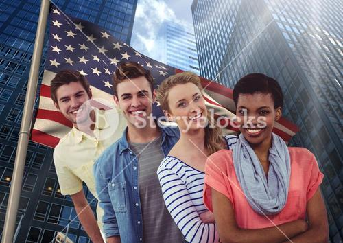 Happy friends standing in a row against american flag