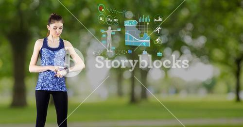 Fit woman using smart watch with futuristic interface