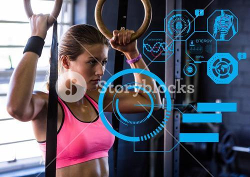 Fit woman exercising in gym with futuristic interface