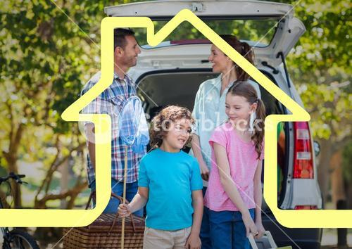 Happy family standing next to car