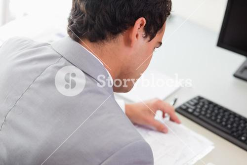 Above view of businessman doing paper work