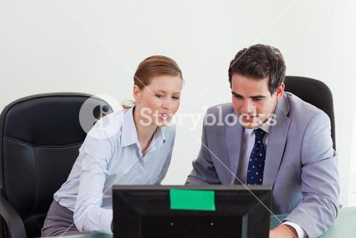 Colleagues working on the computer together