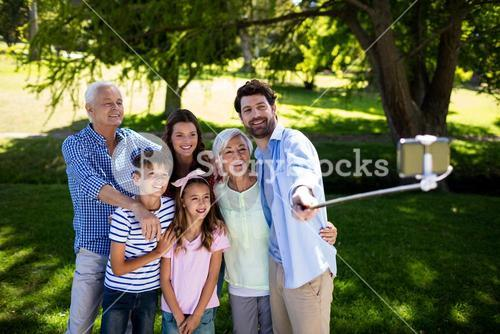 Multi generation family taking a selfie with selfie stick
