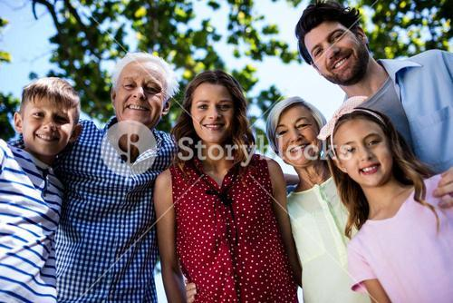 Multi generation family standing in park
