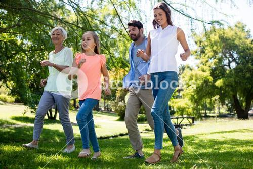 Multi generation family running in park
