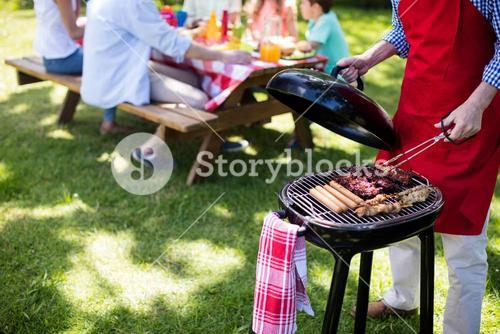 Man barbequing in the park