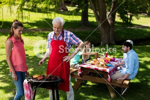 Family preparing barbeque