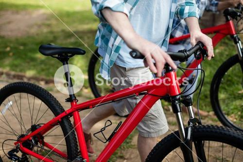 Man walking with bicycle in park