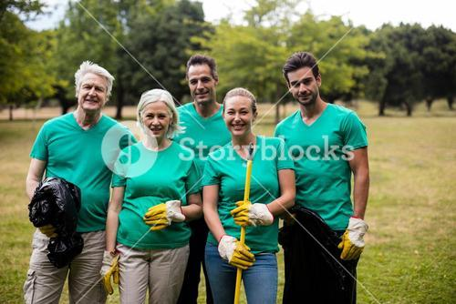 Recycling team members standing in park