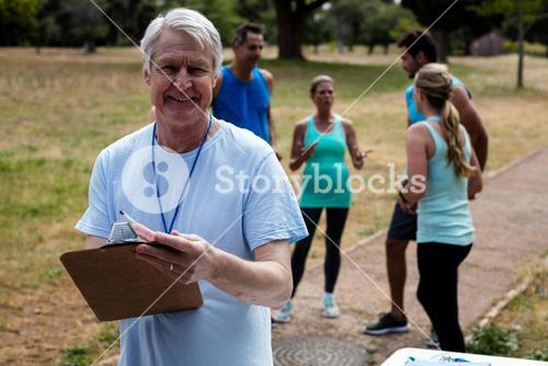 Portrait of male volunteer with clipboard