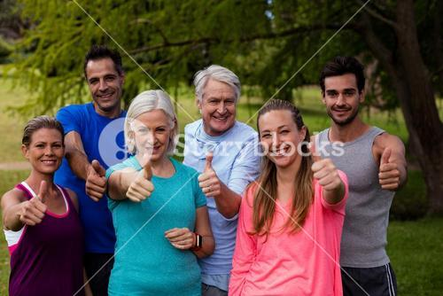 Group of people together showing thumbs up sign