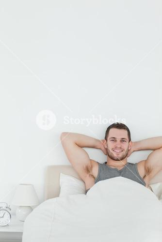 Portrait of a happy man waking up