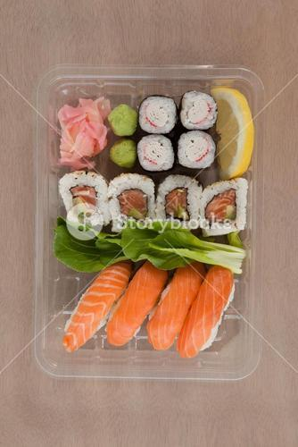 Set of assorted sushi kept in a plastic box