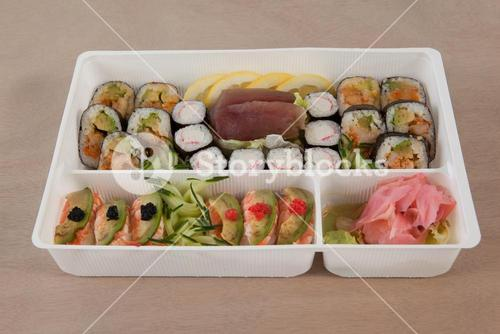 Set of assorted sushi kept in a white box