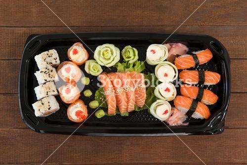 Set of assorted sushi served in a black box