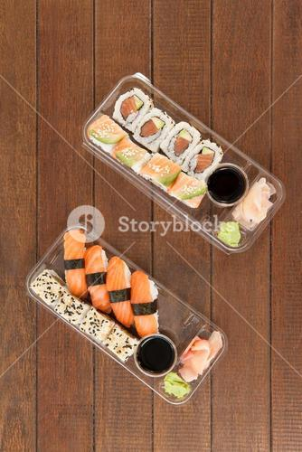 Set of assorted sushi served in a plastic boxes