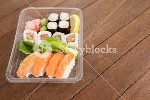 Set of assorted sushi served in a plastic box
