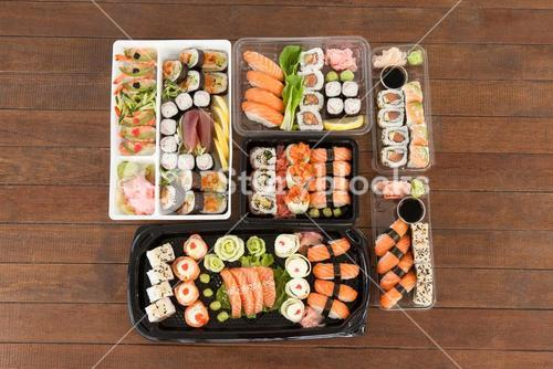 Assorted sushi set served in plastic boxes