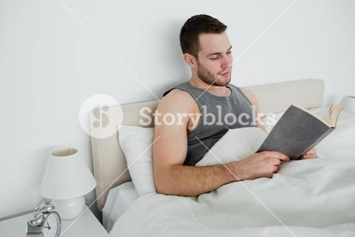 Young man reading a novel