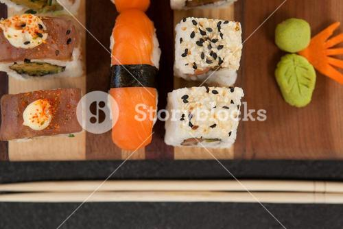 Assorted sushi set served with chopsticks on wooden board
