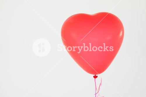 Heart-shaped red balloon