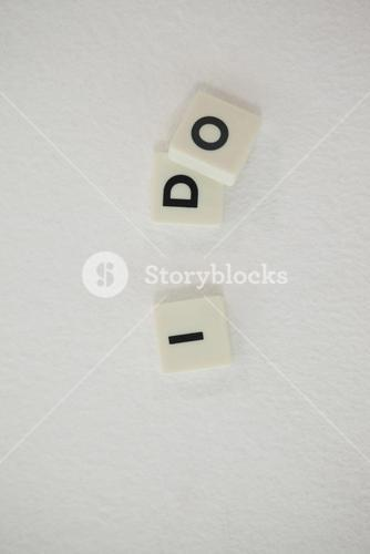 White blocks displaying I DO message