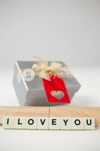 Gift and blocks displaying I love you message