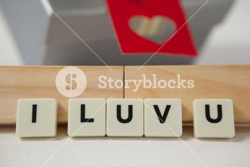 Gift and blocks displaying I luv u message