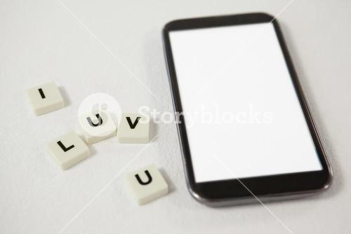 Mobile phone with blocks displaying I love you message
