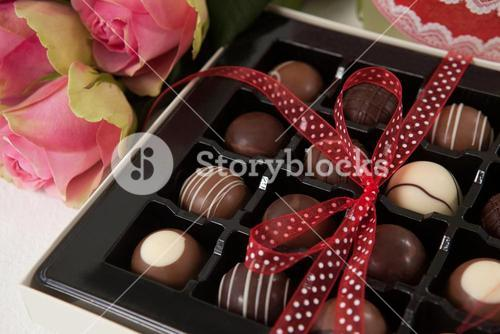 Bunch of roses and assorted chocolate box