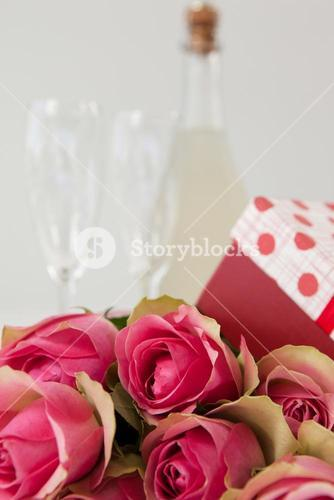 Bunch of roses and champagne bottle